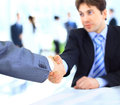 Businessmen shaking hands close up of Stock Photos