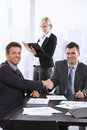 Businessmen shaking hands meeting sitting table assistant background holding organiser Royalty Free Stock Photography