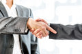 Businessmen showing hand shake gesture close up two in suit inside the office Stock Photography