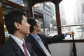Businessmen sitting in double decker tram side view of two Royalty Free Stock Image
