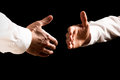Businessmen about to shake hands two on black background Royalty Free Stock Photography