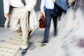 Businessmen walking in the city Royalty Free Stock Photo