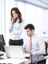 Businessmen working with his colleague together in office Royalty Free Stock Image