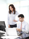 Businessmen working with his colleague together in office Stock Photography