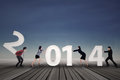 Businesspeople arrange new year 2014 Royalty Free Stock Photo