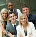 Businesspeople with a blond woman in the middle Stock Photo