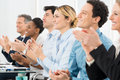 Businesspeople clapping in office happy group of boardroom Stock Photos