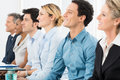 Businesspeople at conference close up of smiling multiracial sitting in a row Royalty Free Stock Photo