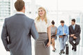 Businesspeople in front of people waiting for interview job office Stock Image