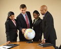Businesspeople with globe. Royalty Free Stock Photo
