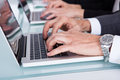Businesspeople Hand's Typing On Laptop