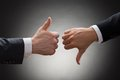 Businesspeople hands showing thumb up and thumb down Royalty Free Stock Photo