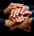 Businesspeople hands their together unity 库存图片