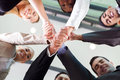 Businesspeople handshaking underneath view of group Royalty Free Stock Photo