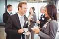 Businesspeople having a discussion during break time Royalty Free Stock Photo