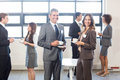 Businesspeople having a discussion during breaktime tea and interacting in office Royalty Free Stock Photo