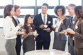 Businesspeople having a discussion during breaktime tea and interacting in office Royalty Free Stock Image