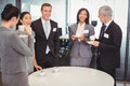 Businesspeople having a discussion during breaktime tea and interacting in office Royalty Free Stock Photography