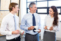 Businesspeople interacting in office during breaktime having tea and Royalty Free Stock Photo