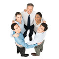 Businesspeople making huddle high angle view of happy Stock Photos