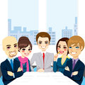 Businesspeople office meeting five at smiling together happy sitting around table Royalty Free Stock Photo
