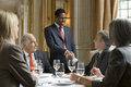 Businesspeople at restaurant table happy in meeting the Royalty Free Stock Photography