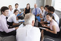 Businesspeople Seated In Circle At Company Seminar Royalty Free Stock Photo