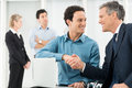 Businesspeople shaking hand portrait of two businessman in office Stock Images