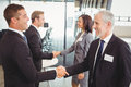 Businesspeople shaking hands with each other Royalty Free Stock Photo