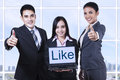 Businesspeople showing thumbs up group of business people like on laptop and Royalty Free Stock Images