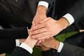 Businesspeople stacking hands close up of on top of each other Stock Photography