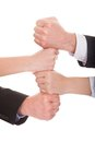 Businesspeople stacking their hands together close up of over white background Royalty Free Stock Images