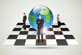 Businesspeople standing around globe on chessboard easy to edit vector illustration of Stock Photography