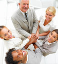 Businesspeople standing together and showing unity Stock Photos