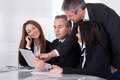 Businesspeople using digital tablet Royalty Free Stock Photo