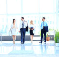 Businesspeople walking in the corrido Stock Photo