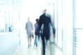 Businesspeople walking in the corridor of an business center pronounced motion blur Stock Photo