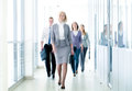 Businesspeople walking in the corridor of an business center pronounced motion blur Stock Photography