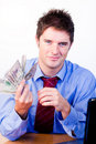 Businessperson holding money Royalty Free Stock Photo