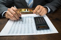Businessperson inspecting financial data close up of with magnifying glass Stock Photography