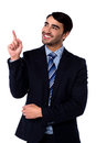 Businesss executive pointing upwards smiling corporate guy at something Royalty Free Stock Photos