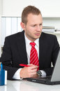 Businesss man with lack of concentration business in office on workplace Royalty Free Stock Photos