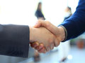 Businesss and office concept - two businessmen shaking hands Royalty Free Stock Photo
