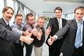 Businessteam mit den Fingern O.K. Stockbild