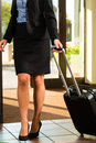 Businesswoman arriving at hotel with her suitcases Stock Photos