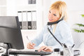 Businesswoman beautiful telephoning and working in the office Royalty Free Stock Photography