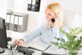 Businesswoman beautiful telephoning and working in the office Stock Images