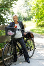 Businesswoman With A Bike In T...