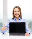 Businesswoman with blank black laptop screen Stock Image