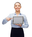 Businesswoman with blank black tablet pc screen business technology internet and advertisement concept smiling pointing finger to Royalty Free Stock Photography